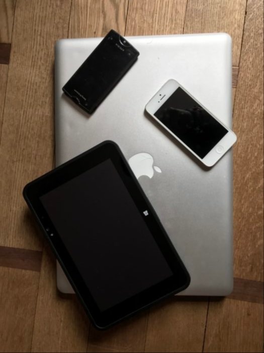 """My 15"""" MacBook Pro compared with a Windows tablet 8"""", an iPhone 5 and a Sony Xperia Ray Android phone."""