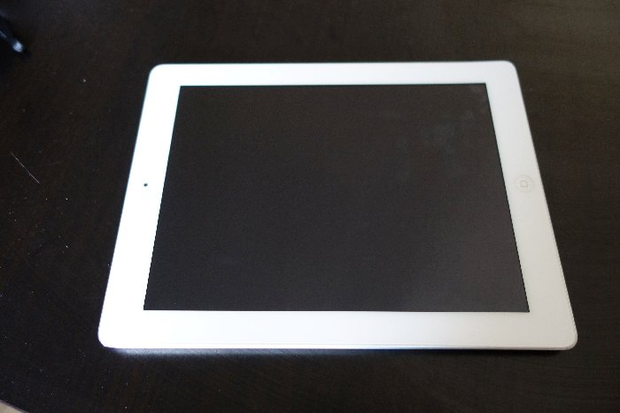 A white iPad tablet - travel photography tips for best way to backup photos