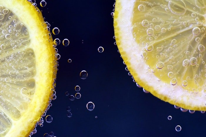 Slices of lemon with bubbles on them shot with macro photography