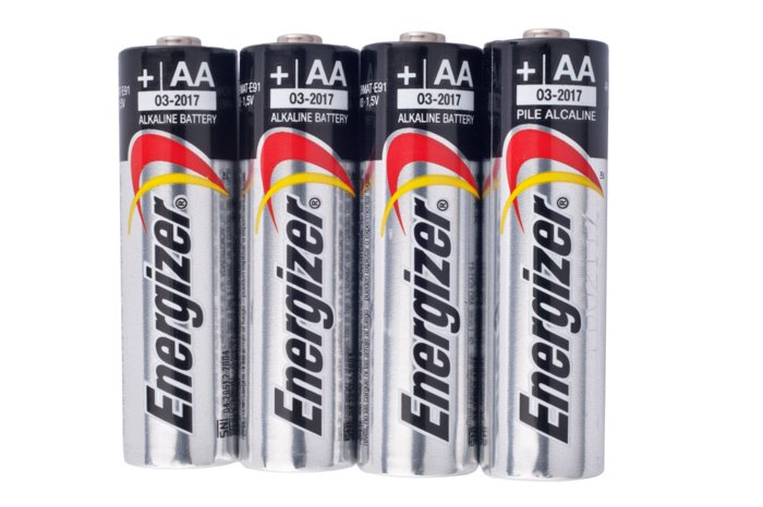 Four Energizer brand AA size alkaline batteries isolated on a white background.