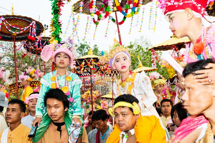 Families take part in the Poi Sang Long festival. Editorial photography.