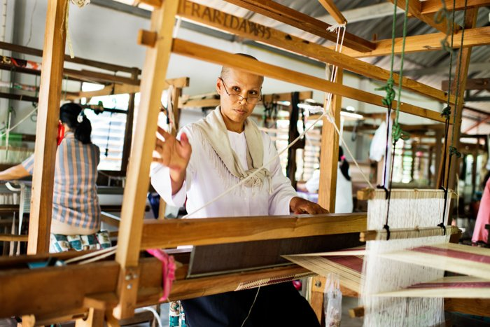 Women weaving silk on a traditional loom in northern Thailand. Editorial photography.