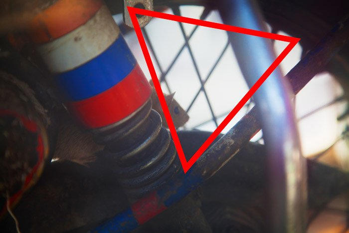Close up photo of machinery parts with red triangle diagram. Naturally framing photography.