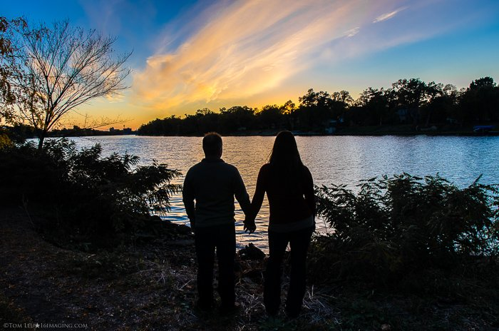 A couple holding hands at sunset - freelance photography job