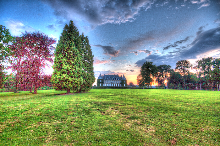 Bright over processed HDR landscape with a castle in the background.