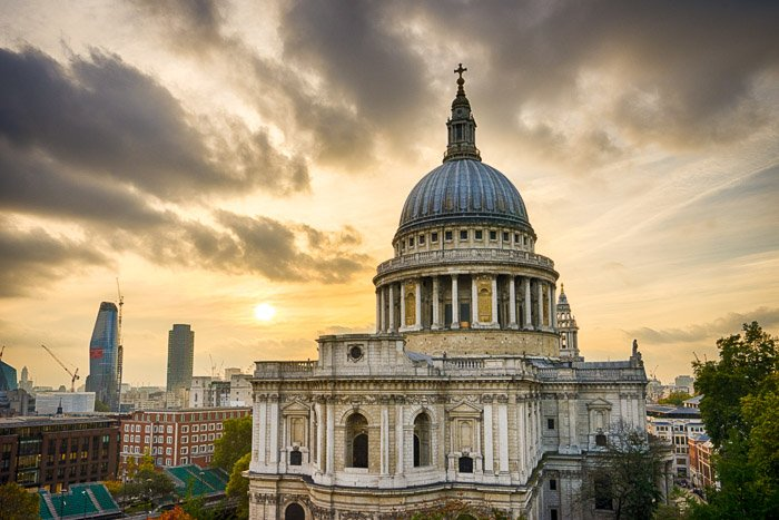 A cathedral against an overcast sky at sunset - travel photography jobs