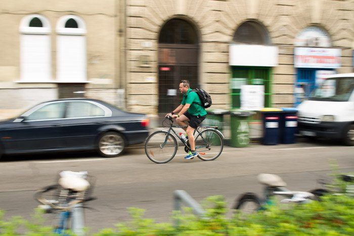 A blurry shot of a cyclist on the street