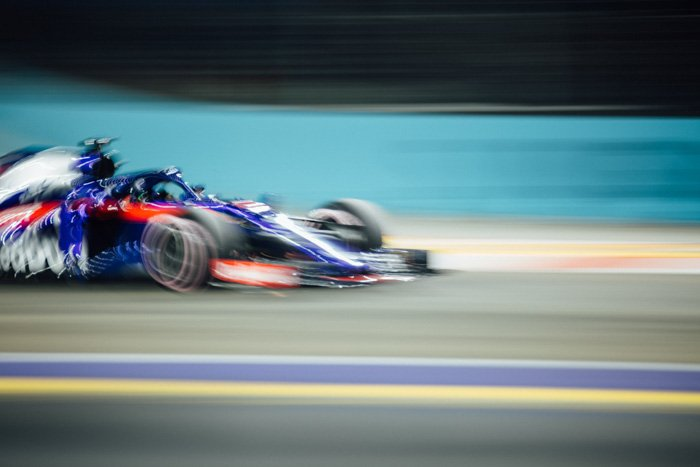 A blurry shot of a F-1 race car