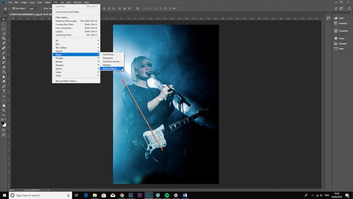 Photoshop interface with selected grainy image for photo retouching