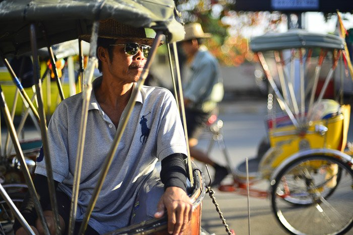 Tricycle taxi rider in Chiang Mai, Thailand.