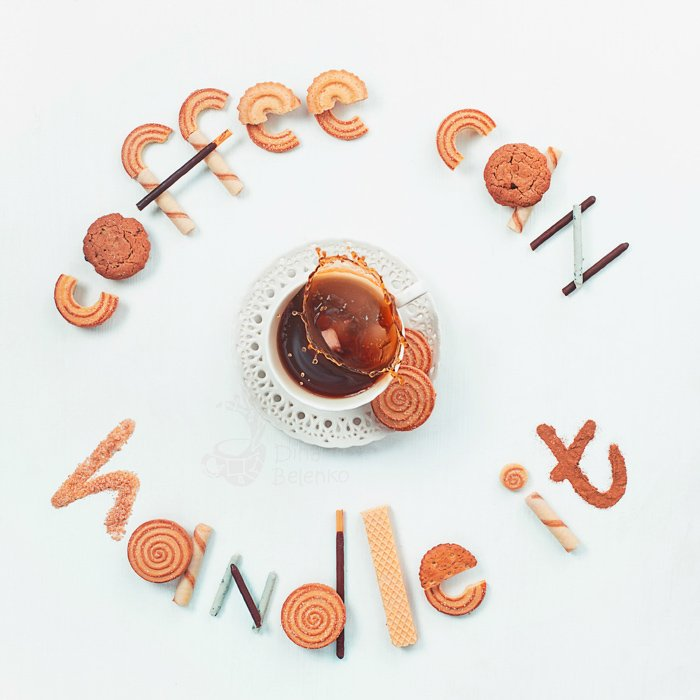 Cool still life photography ideas arrangement of biscuits spelling 'coffee can handle it' framing a coffee cup