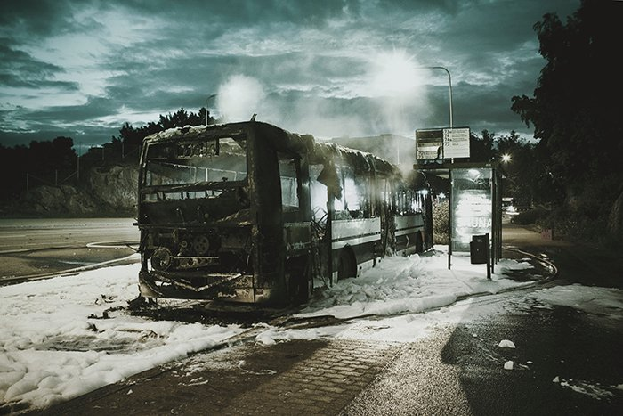 Hans Eiskonen surreal photo of a broken down bus. surreal photography