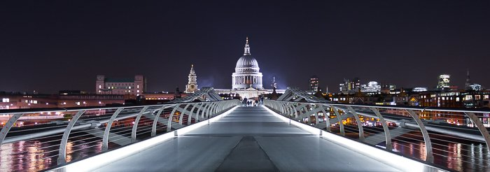 Cityscape view of St. Paul's Cathedral from the Millenium Bridge at night.