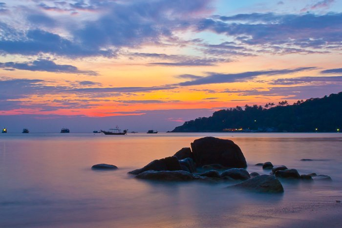 Landscape photography of a sunset at Chalok Baan Kao beach in Ko Tao. Travel photography shot list.