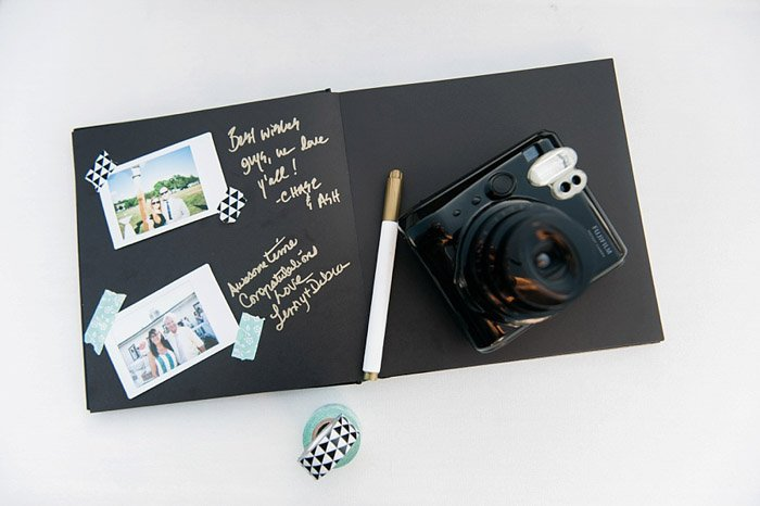 an image of a camera resting on a black paged scrabbook