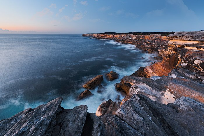 A wide angle scale photo of a beautiful coastal seascape