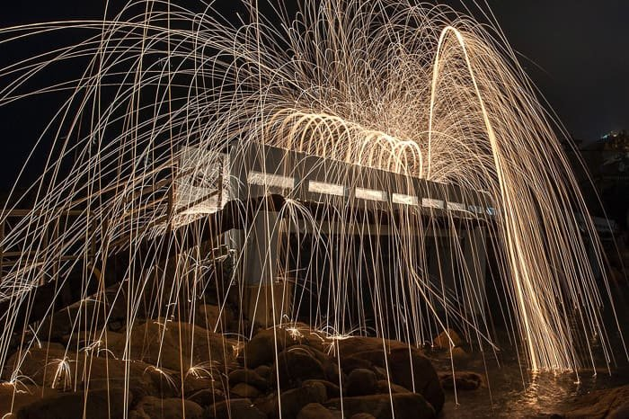 Atmospheric and exciting example of steel wool photography around a building at night