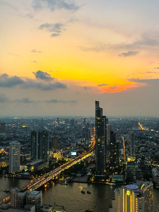 Stunning cityscape photography showing skyscrapers, buildings and a river at sunset