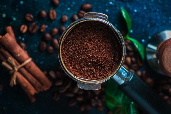 Overhead still life of coffee brewing equipment on dark background