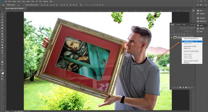 Screenshot of Photoshop editing a picture of a man holding a framed painting