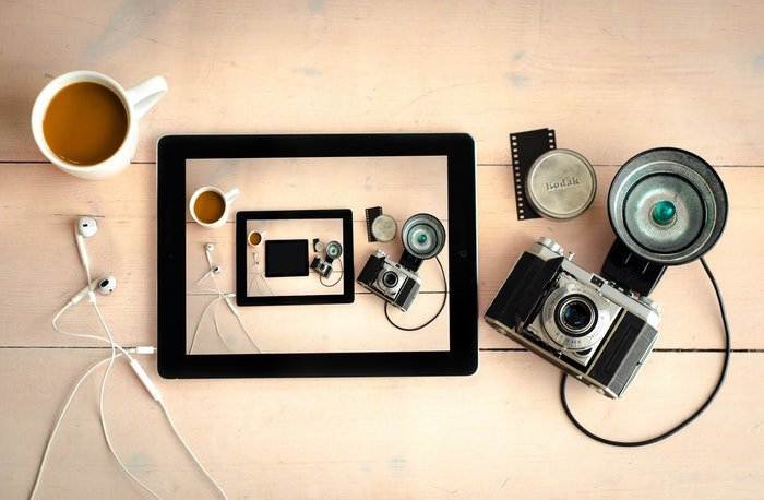 A Droste effect image with a tablet and camera gear