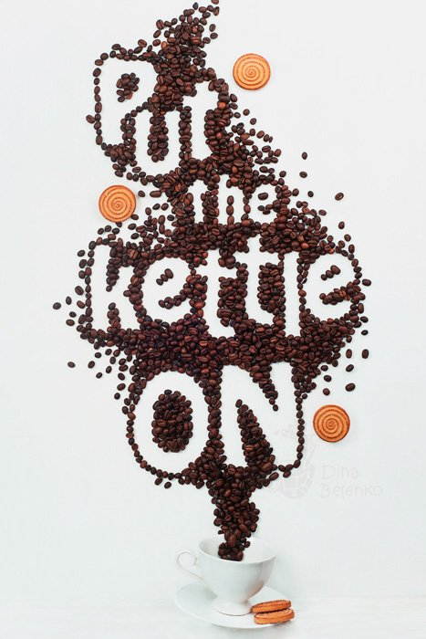 A food art shot featuring coffee cup, saucers, biscuits with food typography message 'put the kettle on'.