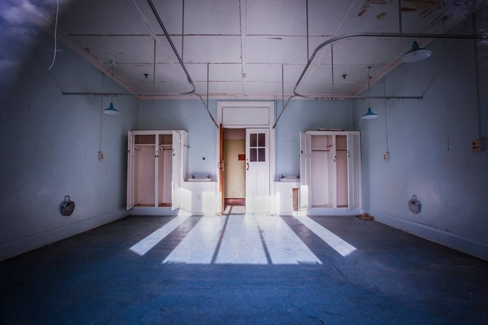 A scary, haunted abandoned hospital room flooded with light - using color in photography.
