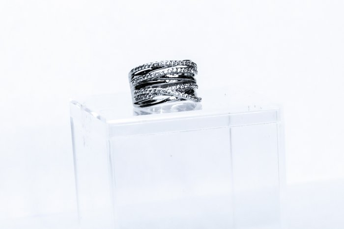 Jewelry product photo close up of a silver ring on a display box
