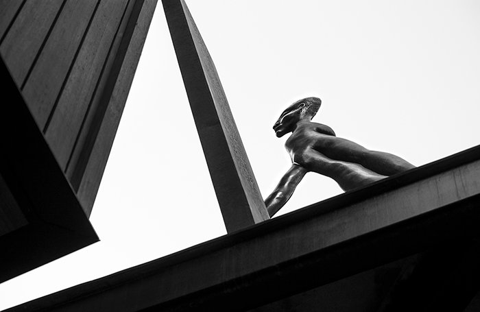 A black and white shot of a street sculpture - street photography lighting