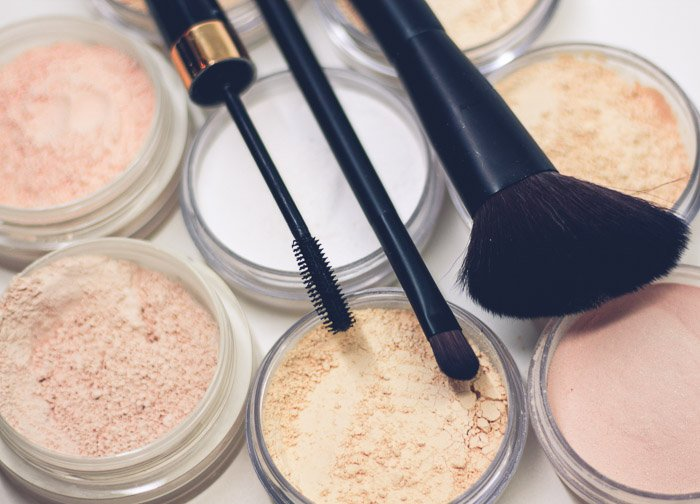 Close up shot of make up and brushes for a boudoir shoot