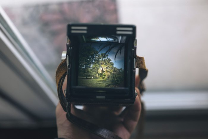looking through the viewfinder of an old film camera