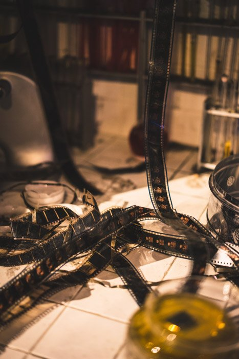 A stream of film photography negatives in a studio setting