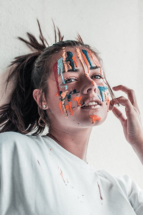 Artistic portrait of a female posing with face paint