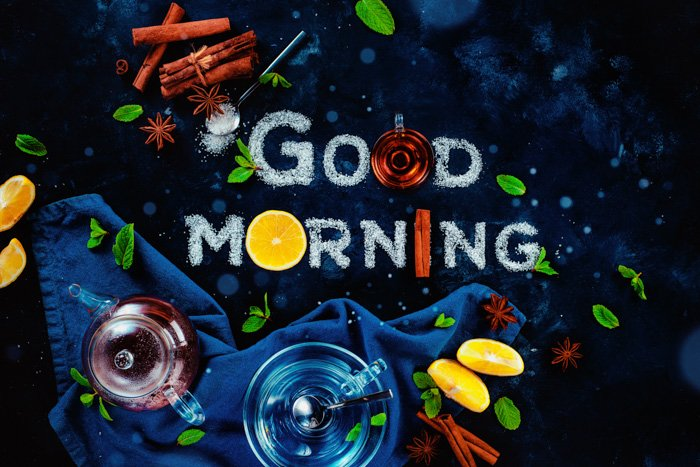 An overhead food art still life with the words 'good morning' created with sugar, fruit and other food typography props