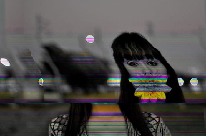 black and white portrait of a girl with colouful glitch effect on photoshop