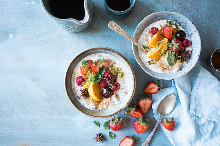 An overhead shot of two bowls of fruity dessert on light background - commercial freelance photography