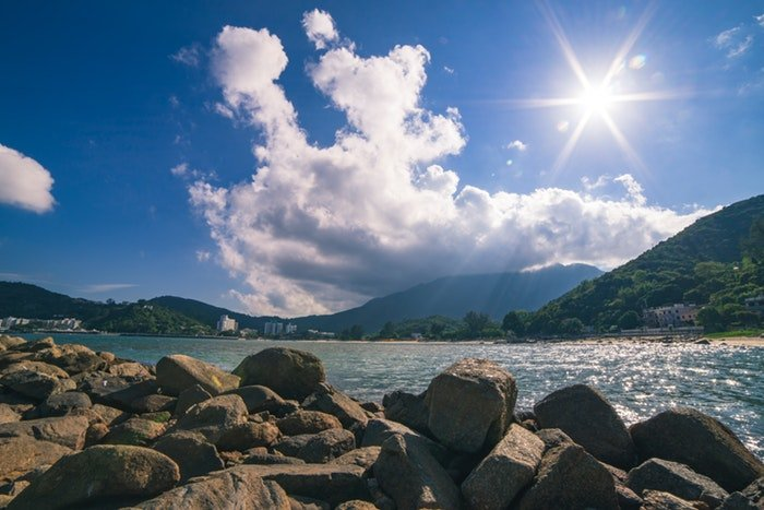 A coastal landscape near mountains on a sunny day