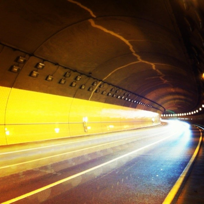 Atmospheric photo of a highway tunnel with streaming light trails an example of long exposure with a smartphone