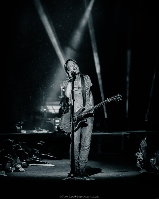 A black and white concert photography live shot of a Keith Urban onstage
