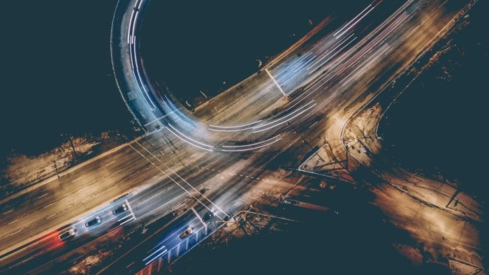 Magnificent overhead double exposure shot of a motorway with colored light trails