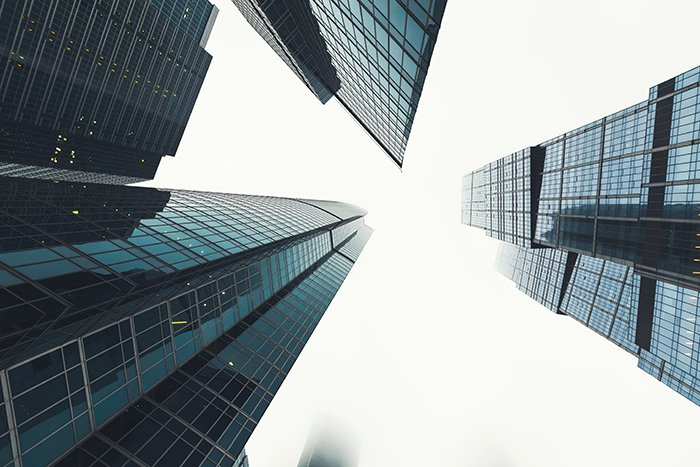 Photo of skyscrapers with glass windows shot with a wide angle lens