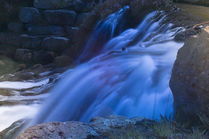 Beautiful indigo waterfall shot with long exposure