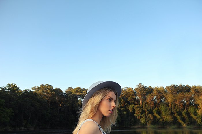 Portrait of a young female model posing in front of a beautiful landscape background