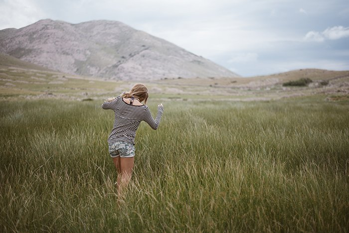 Portrait of a girl walk in front of a beautiful landscape