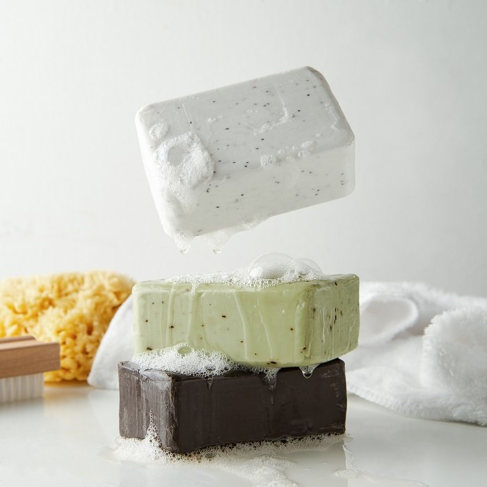 A product photography styling example of a stack of three soaps