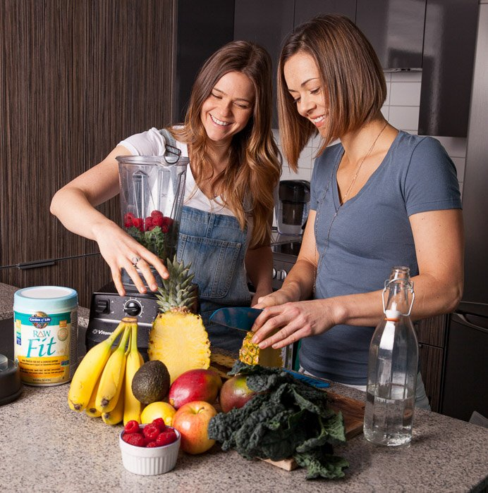 Two girls preparing fruit in a kitchen - product photography tips
