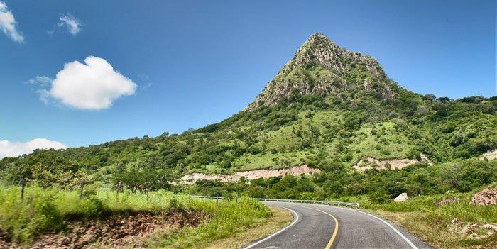 Driving through a luscious mountainous landscape
