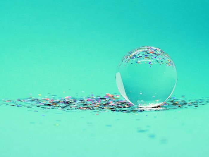 interesting photo of a soap bubble on green background