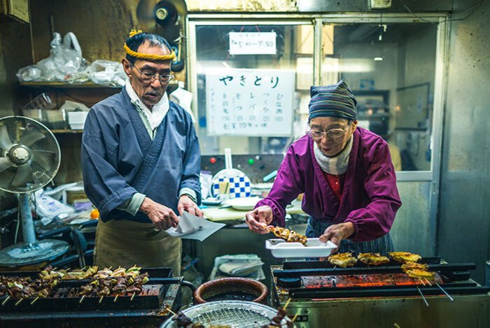 Photo of people at an Asian market food stall shot with a wide angle lens