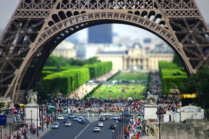 The bottom of the Eiffel tower. The use of tilt shift photography lens makes the scene look like its made from toys.